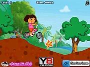 Dora jedzie na rowerze